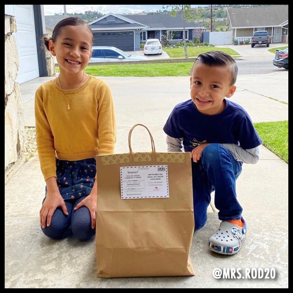 Two kids posing with a Pie-it-forward bag. Image from @mrs.rod20
