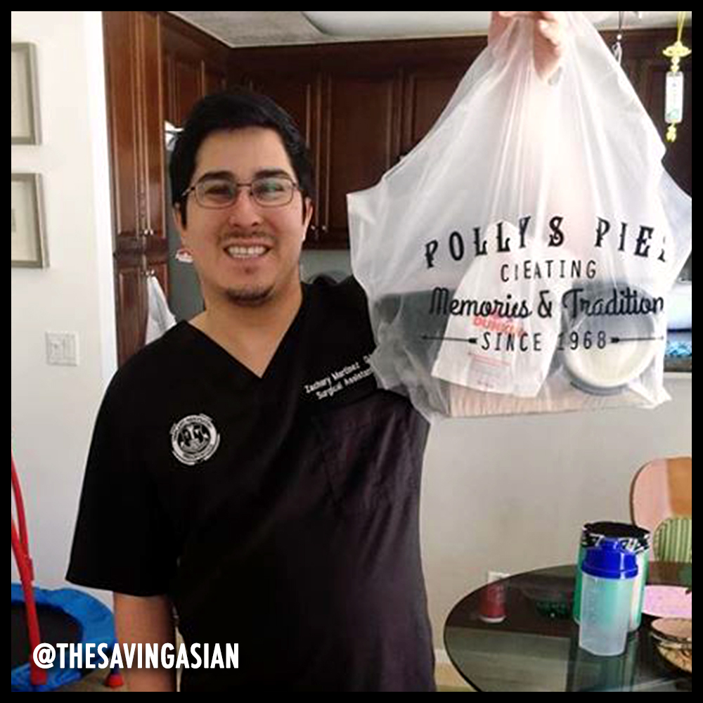 Man holding a to-go bag from Polly's Pies. Image from @thesavingasian